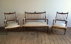 A Louis XVI style three-piece suite - consisting of a settee and two armchairs - France - around 1870/1890