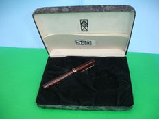 Old fountain pen with side lever charge system made of hard rubber by Delta, Astra series 1995 edition numbered 0668
