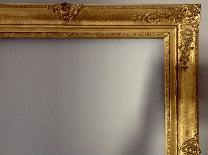 Wooden frame with a gold leaf gilded stucco