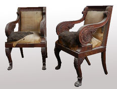 "A pair of Empire style, carved mahogany ""fauteuils à la reine"" - in the manner of Percier & Fontaine - France or Italy - early 19th C"