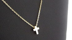 14 kt gold necklace with cross.