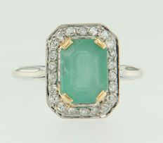 18 kt white gold ring with emerald and Bolshevik cut diamonds.