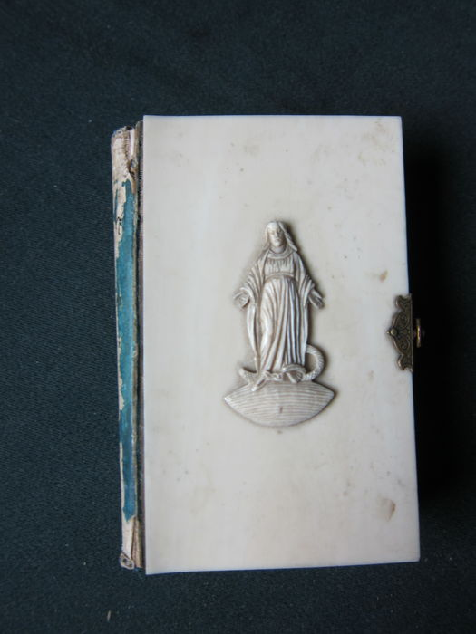 Authentic antique mass book with ivory cover from 1872