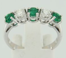 White gold 14 kt, channel ring, set with brilliant cut emerald and diamond.