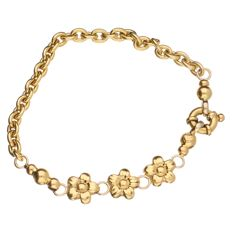 18 kt yellow gold anchor link bracelet with three flower links - length: 19 cm