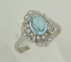 14 kt white gold ring set with topaz and brilliant cut diamonds