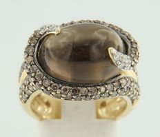 Gold ring 18 kt, with smoky topaz and brilliant cut diamond.
