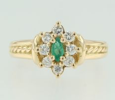 18 kt yellow gold ring set with an emerald cut in marquise shape and 8 brilliant cut diamonds