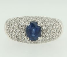 White gold, 18kt ring set with an oval cut, central sapphire and 118 brilliant cut diamonds around it.