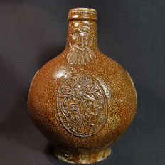 Stoneware Bartmann jug with three coat of arms stamps - H 230 mm