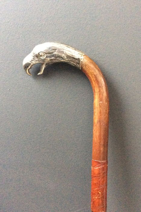 Walking cane with hallmarked silver handle shaped like an eagle's head with glass eyes - appr. 1890