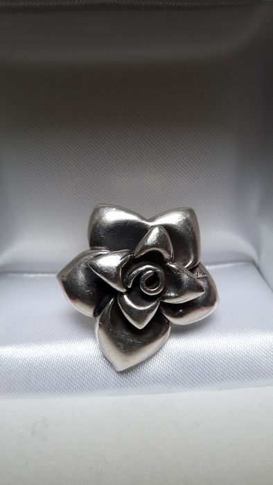 Silver ring with large rose