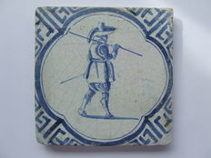 Antique tile with a Warrior in wanli frame.