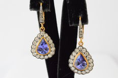 Entourage dangle earrings with pear cut tanzanites and brilliant cut diamonds
