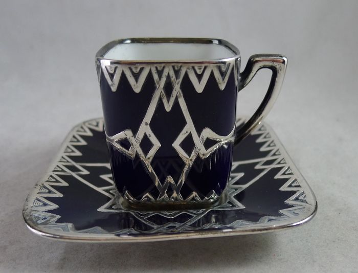 Porcelain cup and saucer with pure silver applique art deco