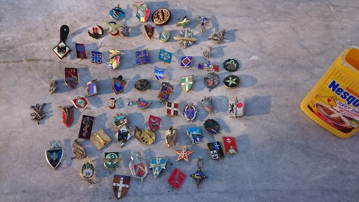 63 French Military badges called pucelles from different army corps