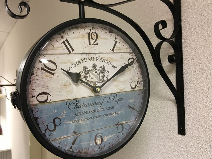 doublesided metal outdoor clock late 20th century