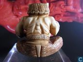 Ivory netsuke of a seated ONI signed KOKU pouring drinks from DOUBLE GOURD Meiji 19th