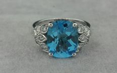 White gold ring set with 12 diamonds and a blue topaz of 3 ct – 3.36 ct in total