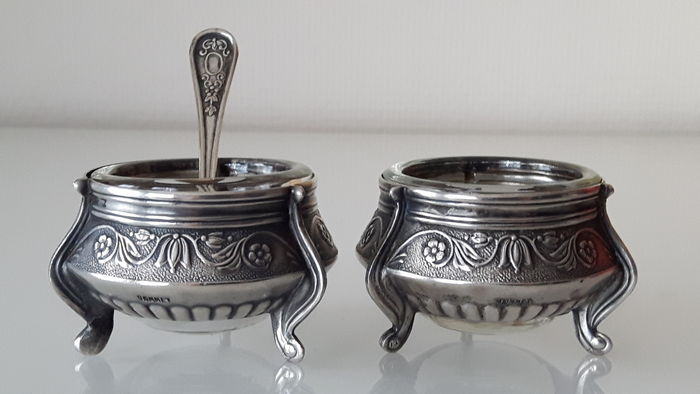 Two Antique salt containers with matching spoon.