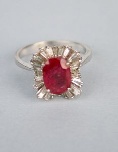 Gold ring set with a 2.6 ct ruby and 26 tapered cut diamonds of 1.38 ct.