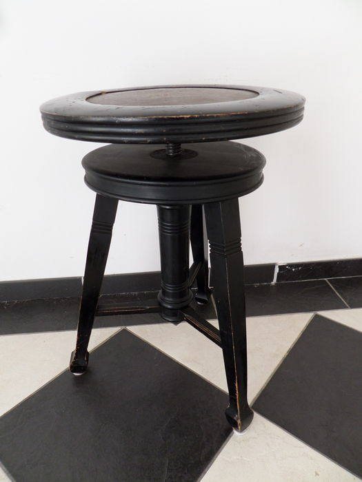 A black wooden piano stool adjustable in height catawiki