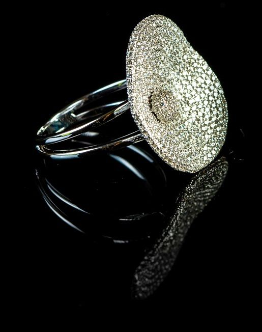 18Kt. white gold fashion dress set with 1.37 ct.,  G/H colour and VS clarity , set in pave setting Ring size 54/N