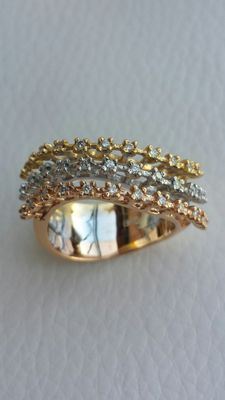 Ring in rose, white and yellow gold, with 0.36 ct diamonds.