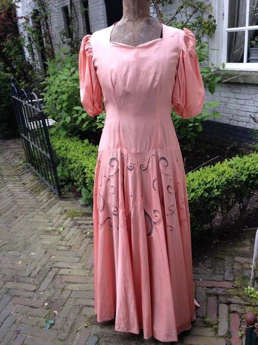 A long salmon pink silk gown - openwork with lace and gebordiuurd ...