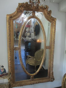 A gilt wood and gesso frame - with facet cut mirror glass -France - circa 1930
