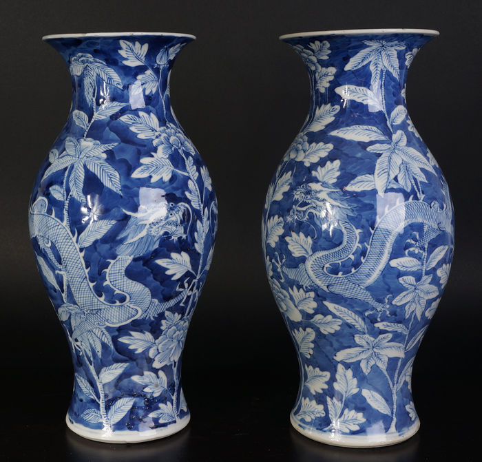 A Set Of Antique Chinese Porcelain Vases With Dragon Decoration