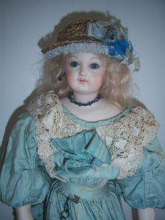 Small Porcelain Doll, Leather Body