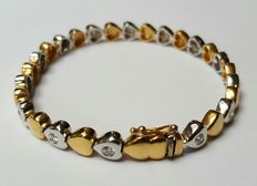 Bi-colour gold bracelet set with 1.12 brilliant cut diamonds.
