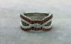 White gold ring set with white and champagne diamonds and orange sapphires