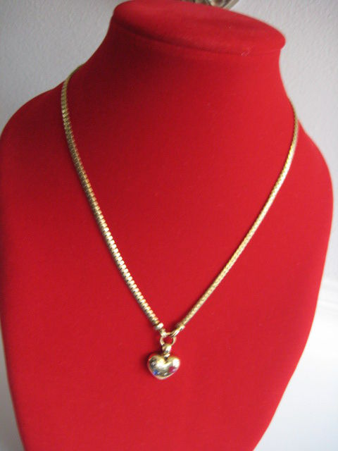 14 kt gold necklace of 42 cm long, with a heart set with brilliant cut diamond, sapphire and ruby.