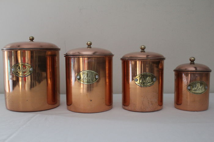 Six piece copper spoon rack and four copper storage containers