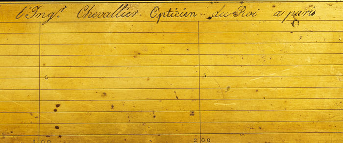 """A 19th century brass protractor signed """"l'Ing. Chevallier Opticien du Roi a Paris """""""