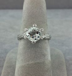 Ring in 18 kt white gold set with 82 diamonds 0.35 ct and a round white Topaz 2.20 ct