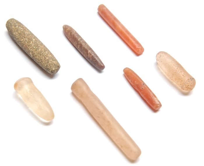 seven neolithic lip and ear plugs made out of quartz carnelian rock crystal and dolerite 2 5. Black Bedroom Furniture Sets. Home Design Ideas