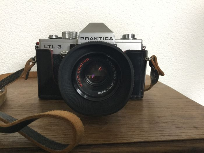 Praktica ltl3 incl. 50mm lens on the camera and lens pallas f1:2.8