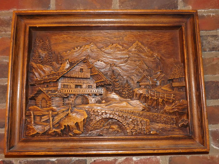 Panoramic panel made of carved resin wood in relief a