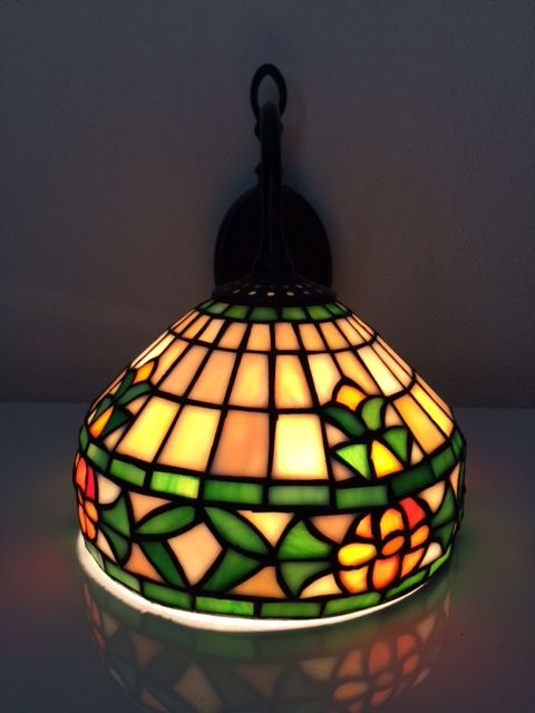 Tiffany wall light with stained glass on a nice decorative wall ...