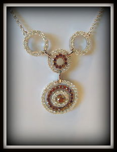 Necklace set with 83 white diamonds, 1.61 ct, and 31 intense red diamonds, 0.83 ct, total 2.44 ct.