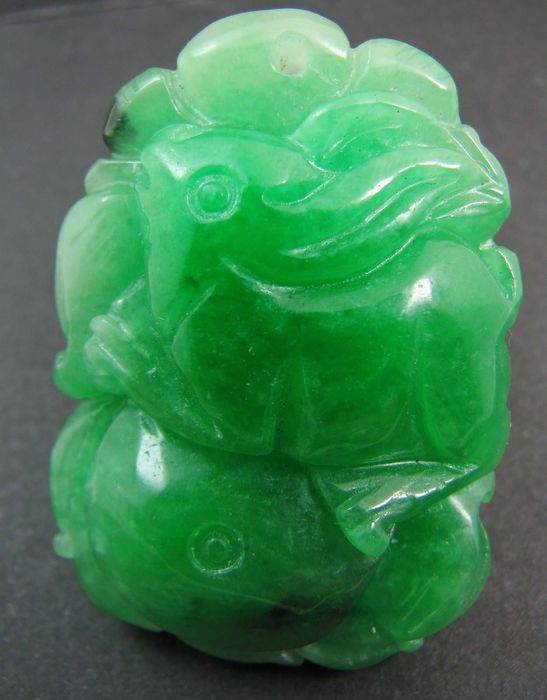 A hand carved green jadeite jade pendant or amulet of a rabbit a hand carved green jadeite jade pendant or amulet of a rabbit aloadofball Images