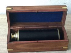 Brass extendable telescope in wooden box.