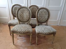 A set of four Louis XVI style grey, white protected chairs, France, approx. 1900