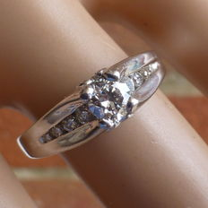 "Total weight 0.60 carat Diamond, 900 Platinum Ring. size ""6 1/2"" US , ""N"" UK or 14/54 EU,"