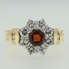bi-colour gold entourage ring set with brilliant cut garnet and diamond