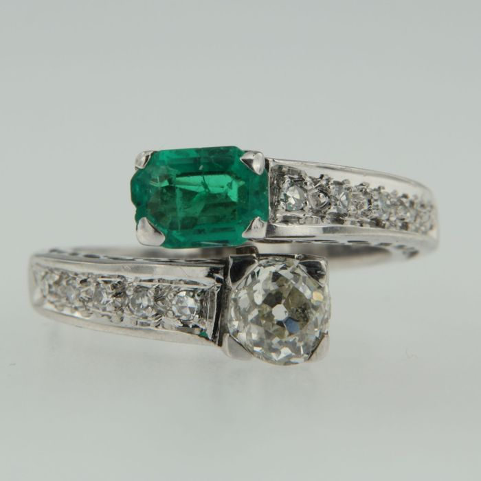 white gold channel ring set with emerald and