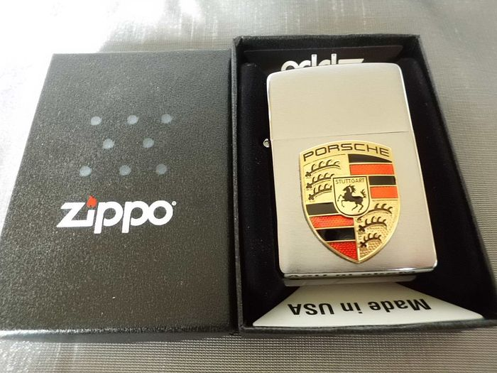 Zippo cigarette lighter with Porsche enamel sign , Catawiki